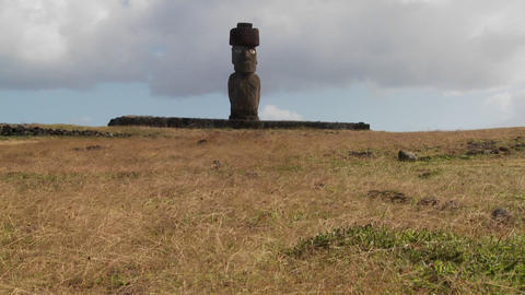 Wind blows across the grass in this lonely Easter Island... Stock Video Footage
