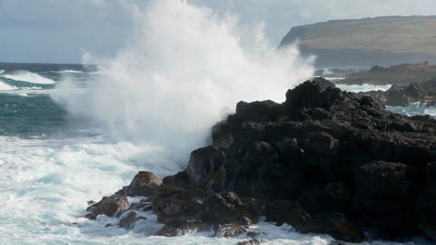 Big waves roll into a tropical island and crash onto the... Stock Video Footage