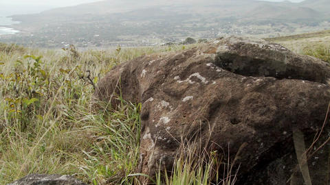 Mysterious stone carvings adorn a lookout spot for birdmen on Easter Island Footage