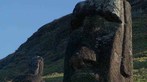 Giant half carved faces stand at the quarry on Easter Island Stock Video Footage
