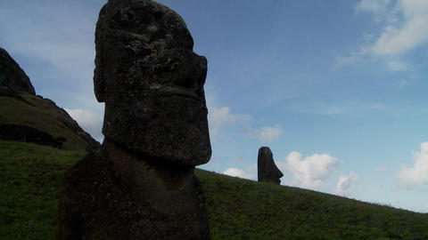A time lapse of clouds moving behind Easter Island statues Stock Video Footage