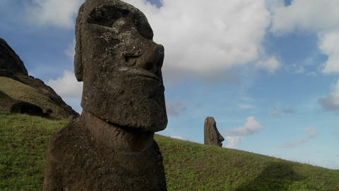 A time lapse of clouds moving behind Easter Island statues Footage