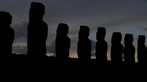 A pan across Easter Island statues at dusk Footage