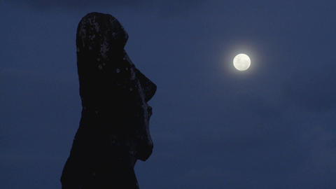 An Easter Island statue is silhouetted in the moonlight... Stock Video Footage