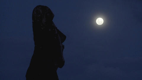An Easter Island statue is silhouetted in the moonlight in this amazing time lapse Footage