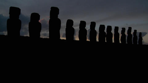 A long line of statues is silhouetted on Easter Island Footage