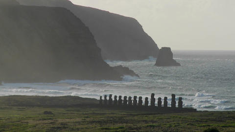 Easter Island statues stand in the distance against the... Stock Video Footage