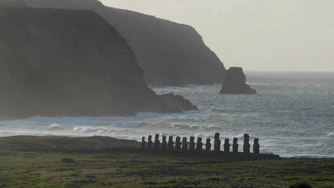Easter Island statues stand in the distance against the Pacific Ocean Footage