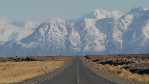 An empty road heading into the Andes mountains in the... Stock Video Footage