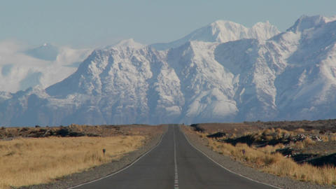 An empty road heading into the Andes mountains in the rmote Argentine region of Patagonia Footage
