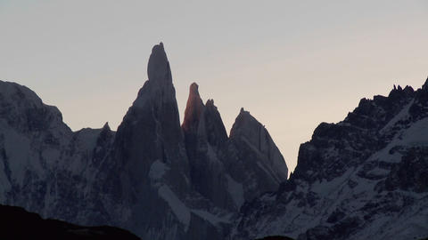 The remarkable mountain range of Fitzroy in Patagonia, Argentina with snowclad glacier at dusk Footage