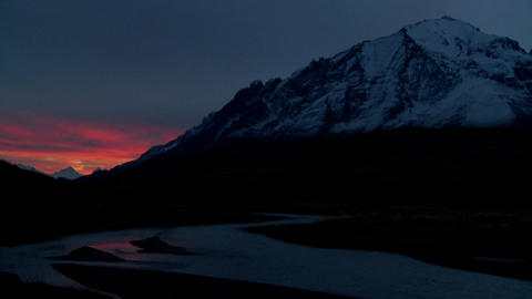 A beautiful deep sunset behind mountains in far Southern Argentina, Torres Del Paine, Patagonia Footage
