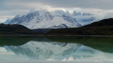 A beautiful lake in front of the peaks of Torres Del... Stock Video Footage