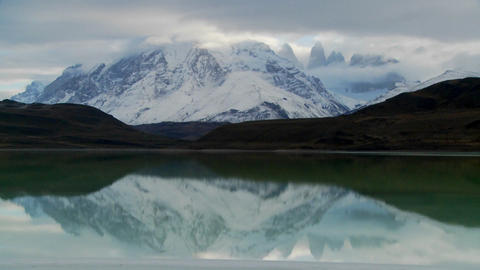 A beautiful lake in front of the peaks of Torres Del Paine in Patagonia, Argentina Footage