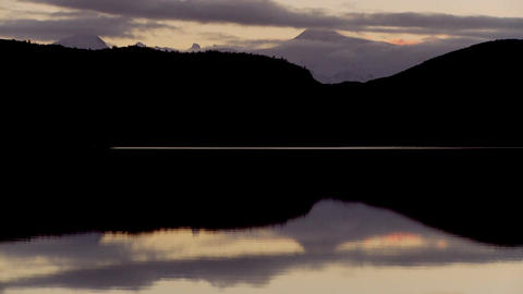 Pan across lakes and peaks in Patagonia, Argentina at dusk Stock Video Footage