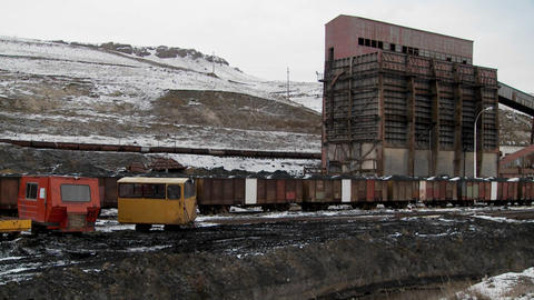 Tilt down to polluted channel at abandoned mining camp in... Stock Video Footage