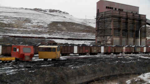 Tilt down to polluted channel at abandoned mining camp in Argentina Footage