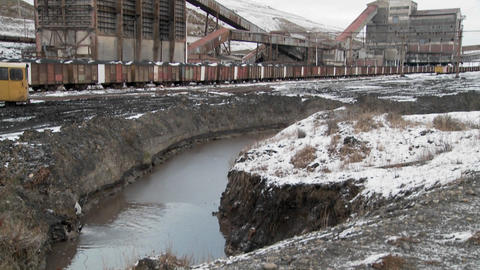 Tilt down from an abandoned mine to a polluted irrigation... Stock Video Footage