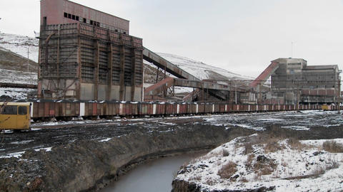 Pan across an abandoned mine with ore rail cars in the... Stock Video Footage