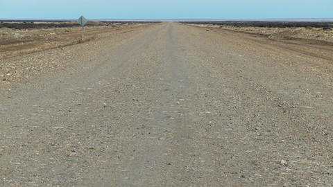 A perspective down a lonely abandoned road Stock Video Footage