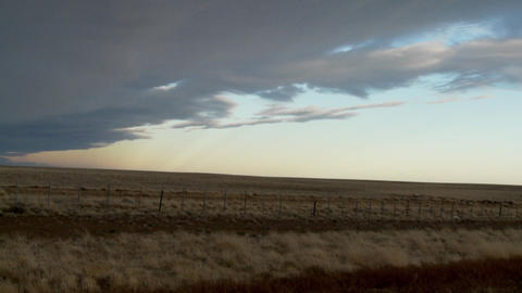 Dark clouds move over the landscape in this time lapse... Stock Video Footage