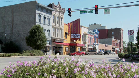 A park bench and Main Street in the all American town of Ottawa Kansas Footage