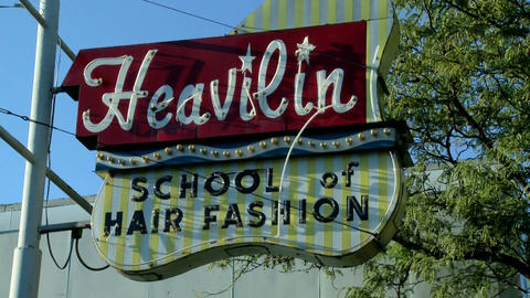 A sign in Kansas City reads Heavilyn Beauty College Stock Video Footage