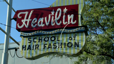 A sign in Kansas City reads Heavilyn Beauty College Footage