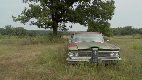 An old abandoned Ford Edsel sits in a field Footage