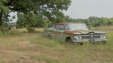 An old Ford Edsel sits in a field Live Action