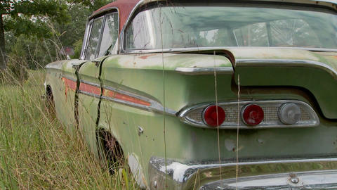 An old Ford Edsel sits in a field Stock Video Footage