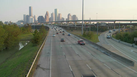 Cars move along a highway near Houston, Texas Stock Video Footage