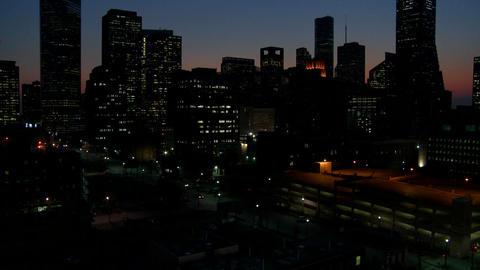 Tilt up to the Houston skyline at dusk Stock Video Footage
