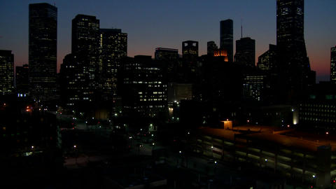Tilt up to the Houston skyline at dusk Stock Video Footage