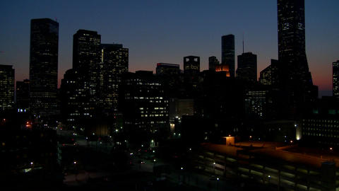 Tilt up to the Houston skyline at dusk Footage