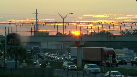 Time lapse of the morning commute as the sun rises Stock Video Footage