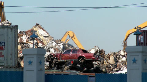 Cranes lift and move scrap metal around abandoned and... Stock Video Footage