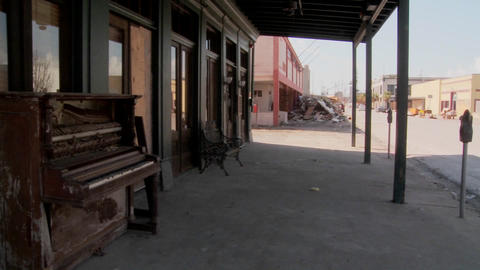 Pan across devastated Galveston street after Hurricane Ike and an old piano sitting in front of an a Footage