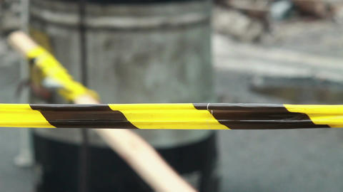 Yellow black striped tape outdoors, police investigation line Footage