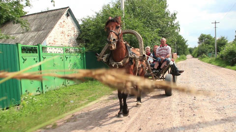 Village people ride on horse cart, summer day, poor villagers Footage
