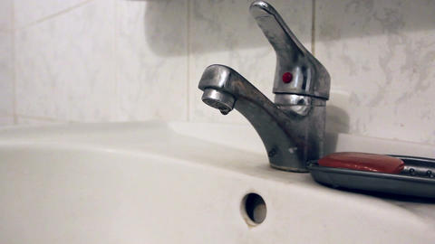Old bathroom faucet, tap turned on off hand, flowing water Footage