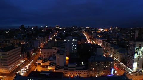 Night city timelapse, traffic cars move on streets, dark sky Footage