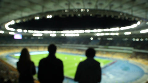 Silhouettes out of focus football fans shouting for team stadium Footage
