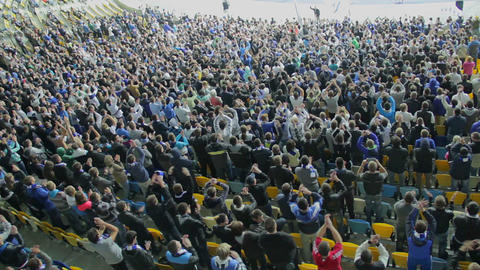 Thousand supporters of football team clap in sync, stadium match Footage