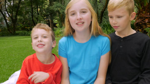 A young family tries to set up for a family portrait and fails in slow motion. O Footage