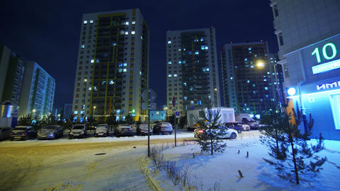 district with high block buildings in cold winter evening Live Action