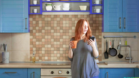 Dancing fun, listening to music on smartphone. Attractive girl with red hair Live Action
