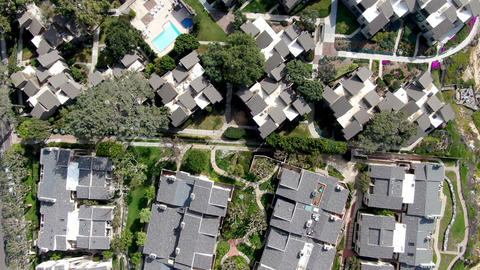 Aerial view of condo community with tennis court and pool in South California Live Action