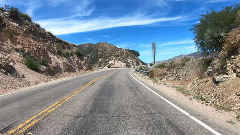 Road trip in Angeles National forests mountain with blue sky, California, USA Live Action