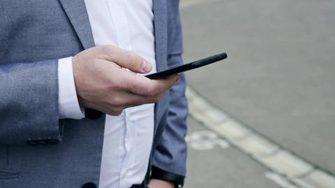 Businessman using smartphone Outdoors in front of Office Building. Texting, Sms, Internet Surfing, GIF